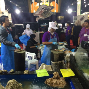 Shucking action at the seafood stall