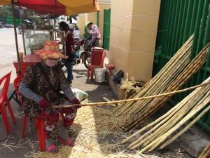 Preparing sugar cane juice on the streets in Phnom Penh